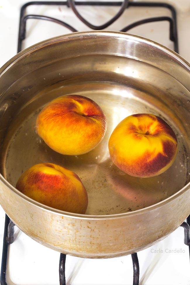 Large pot of water with peaches