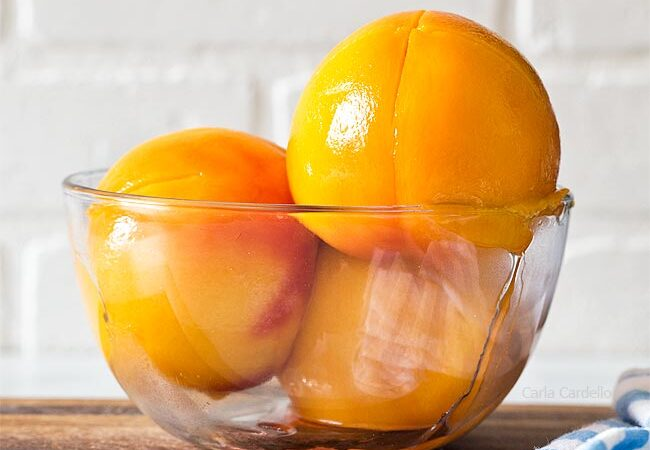 peeled peaches in a glass bowl
