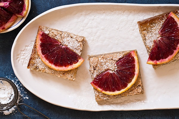 Blood Orange Bars are a twist on classic lemon bars with a melt-in-your-mouth buttery crust and a soft jelly-like orange filling. Make them before blood orange season is gone!