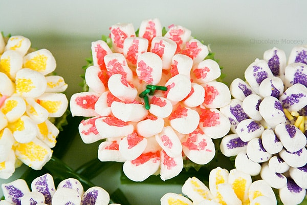 Moist and tender small batch Lemon Butter Mum Cupcakes are decorated with marshmallows to look like flowers.