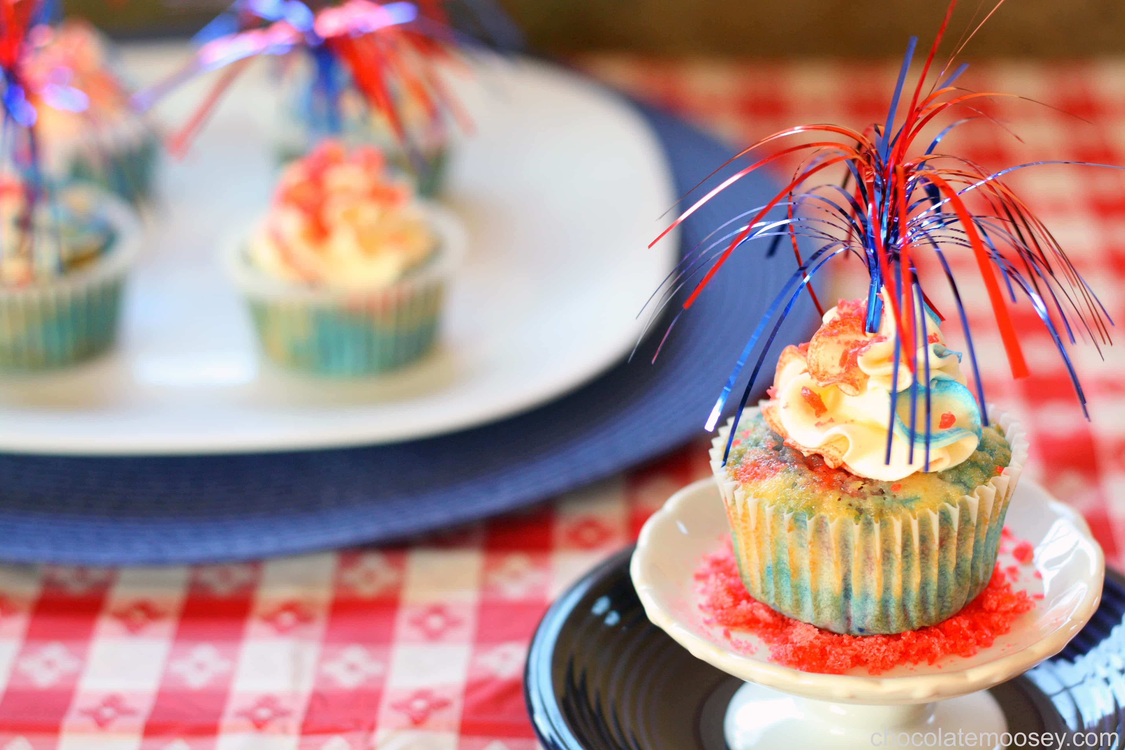 Red, White, and Blue Firecracker Cupcakes from www.chocolatemoosey.com