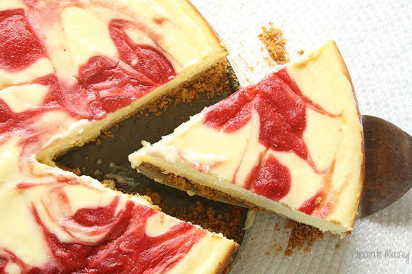 A classic cheesecake with a strawberry swirl on top
