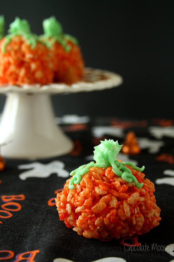 Candy-Stuffed Rice Crispy Treat Pumpkins with a fun candy surprise in the middle