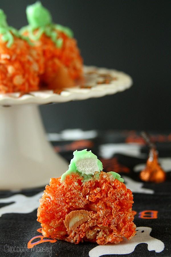 Candy-Stuffed Rice Crispy Treat Pumpkins cut in half for a surprise inside