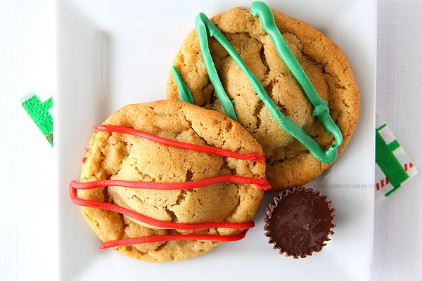 What's better than a single peanut butter cookie? Double Peanut Butter Surprise Cookies stuffed with a peanut butter cup and drizzled with chocolate on top.