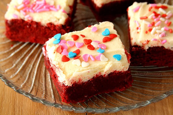 Small Batch Red Velvet Sugar Cookie Bars from scratch without cake mix, complete with a small batch of cream cheese frosting and sprinkles.