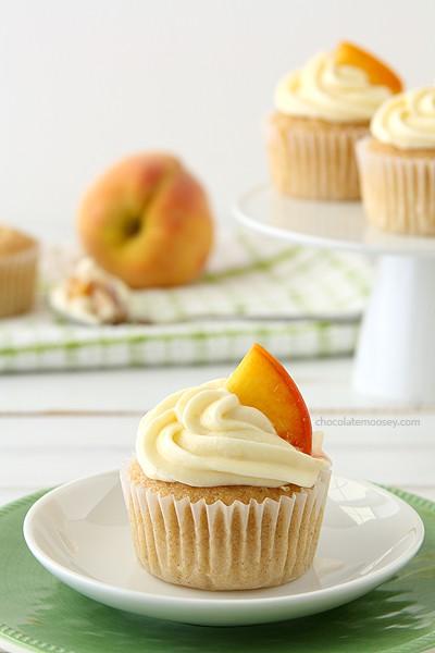 Peaches and Cream Stuffed Cupcakes   www.chocolatemoosey.com