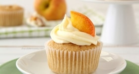 Peaches and Cream Stuffed Cupcakes | www.chocolatemoosey.com