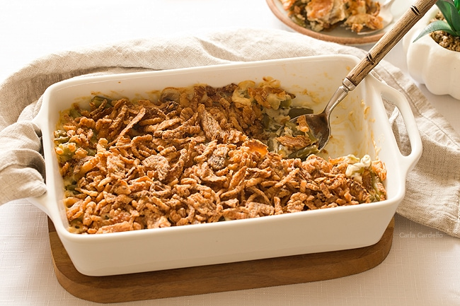 Don't want to cook with canned cream of mushroom soup or canned green beans? Here is my favorite easy green bean casserole from scratch for Thanksgiving and Christmas using frozen green beans, fresh mushrooms, and sour cream.