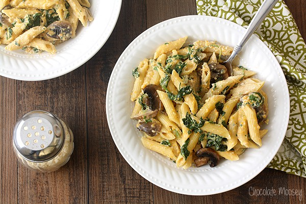 When winter squash is in season, turn it into a hearty comforting dinner for two with Butternut Squash Alfredo with pasta, spinach, and mushrooms.