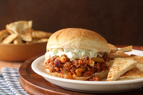 Greek Sloppy Joes made with ground lamb, peperoncini, feta cheese, and cucumber yogurt sauce