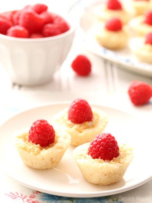 Raspberry Coconut Mini Pies brings a bit of elegance to dessert tables with homemade pie crust, coconut pudding, and sweet whole raspberries.