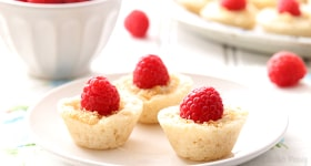 Raspberry Coconut Mini Pies brings a bit of elegance to dessert tables with homemade pie crust, coconut pudding, and sweet whole raspberries