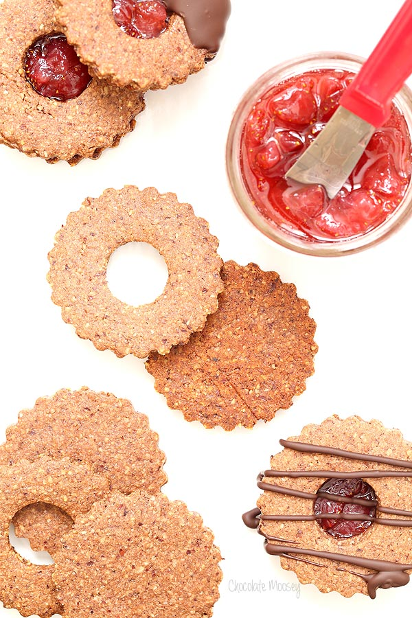 Chocolate Covered Strawberry Linzer Cookies made with hazelnut flour and strawberry jam