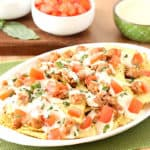 Italian Nachos with hot sausage, mozzarella cheese, tomatoes, basil, and Pasta Chips