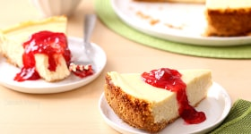 Classic Cheesecake recipe served with strawberry jam