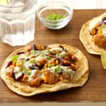 Barbecue chicken and corn on top of oven baked tostadas with hummus