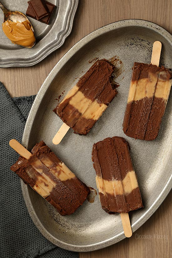 Chocolate Peanut Butter Fudgesicles that taste like eating a peanut butter cup on a stick
