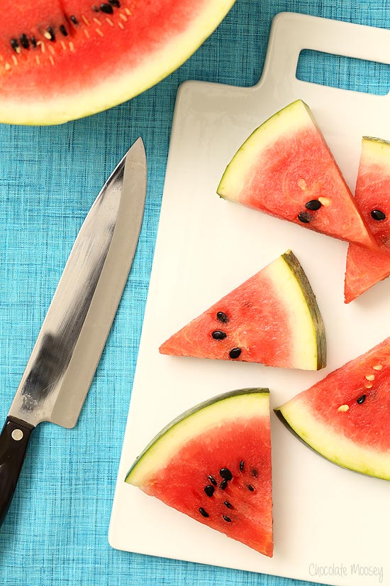 Watermelon slices on cutting board