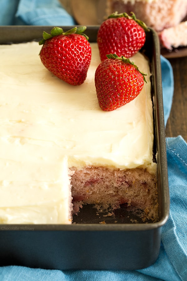 This fresh strawberry snack cake from scratch with homemade cream cheese frosting is made in an 8x8 pan without cake mix or Jello. Its natural pink color comes from fresh strawberries.