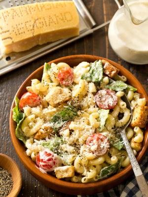 Bowl of Caesar Pasta Salad with spoon