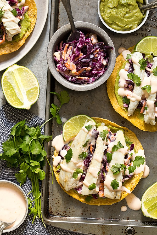 Sweet Chili Fish Tostadas topped with guacamole, sweet chili slaw, and flaky white fish make an easy summertime meal.