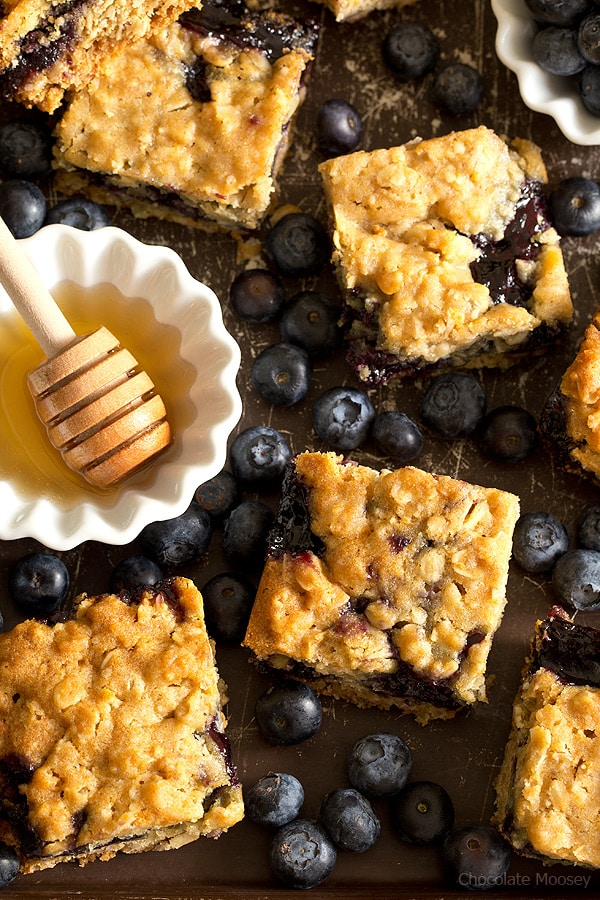 Soft, moist, and reminiscent of oatmeal cookies, Honey Blueberry Oatmeal Bars are filled with a homemade blueberry honey jam without pectin.