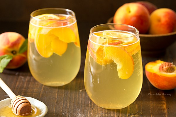 Summer is for sipping sangria: Peach Honey Sangria made with white wine, fresh peaches, and honey