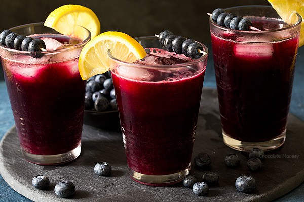 Ditch the drink mix and make a refreshing pitcher of homemade Sparkling Blueberry Lemonade from freshly squeezed lemons and a homemade blueberry syrup.