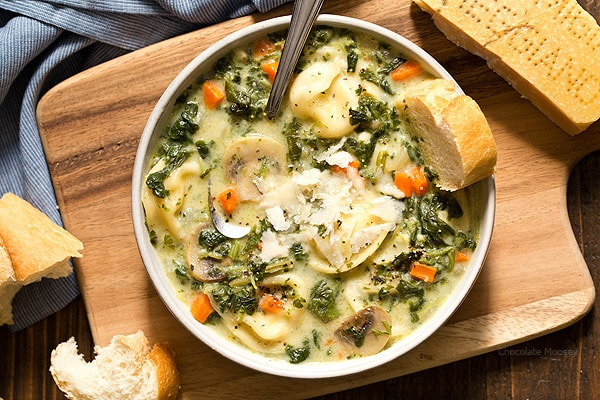 When there's a chill in the air, that means it's time for One Pot Spinach Mushroom Dumpling Soup - a hearty and filling dinner ready from prep to table in under 60 minutes. Made with spinach, mushrooms, carrots, and pelmeni dumplings.