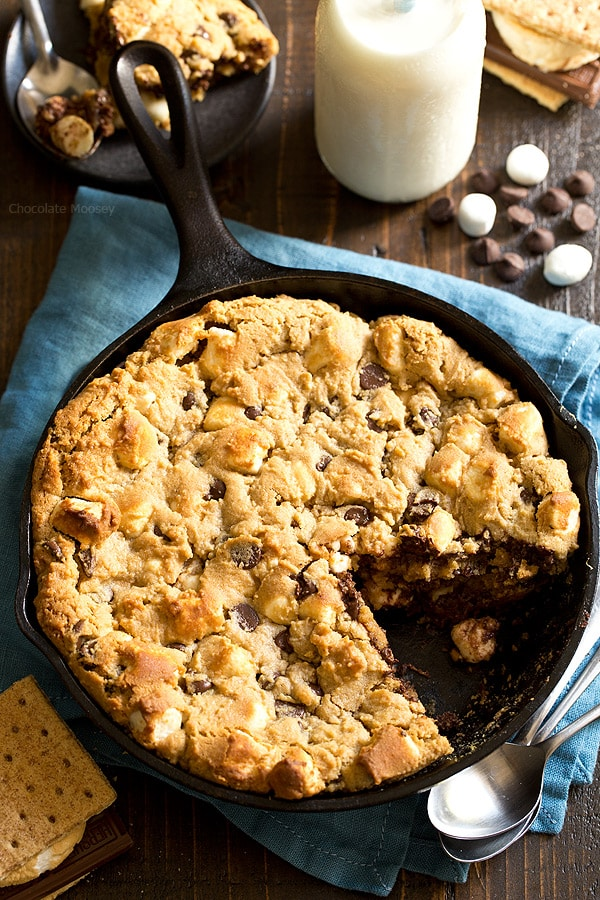 The taste of s'mores right from your oven! Peanut Butter S'mores Chocolate Chip Skillet Cookie combines graham crackers, toasted marshmallows, chocolate chips, and peanut butter into one heavenly dessert.