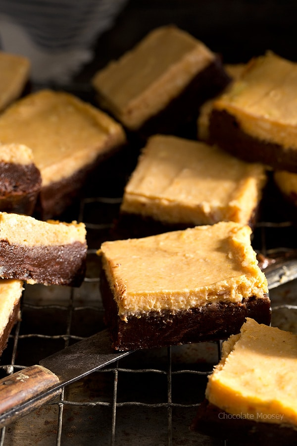 When two desserts become one with a fall twist - Pumpkin Cheesecake Brownies with a chocolate cinnamon brownie bottom and a creamy pumpkin layer on top.