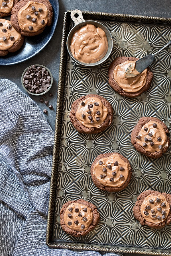 Hate cutting out sugar cookies? No need to roll and cut dough with Soft Chocolate Sugar Cookies! Just scoop and bake then frost with a creamy chocolate frosting. Top with chocolate sprinkles or mini chocolate chips.