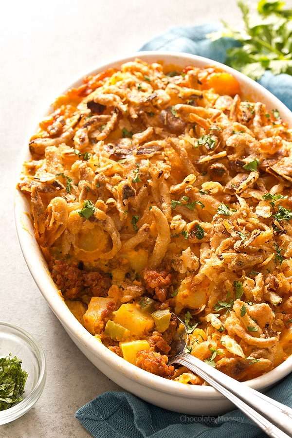 Homemade Cheesy Chorizo Potatoes made from scratch without canned soup doubles as both dinner and brunch. Elegant enough for the holidays yet casual enough for family dinner. Top them with French fried onions for a flavorful crunch.