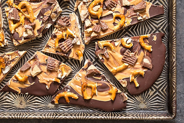 Satisfy your sweet tooth with sweet and salty Chocolate Peanut Butter Pretzel Bark with peanut butter cups. Make it as a gift or keep it all to yourself.