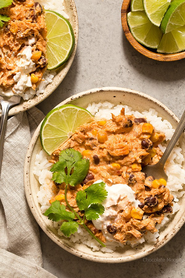 Warm and spicy small scale Slow Cooker Salsa Chicken served over rice with cilantro and lime. Recipe is scaled down to make 4 servings, enough to realistically feed 2 people.