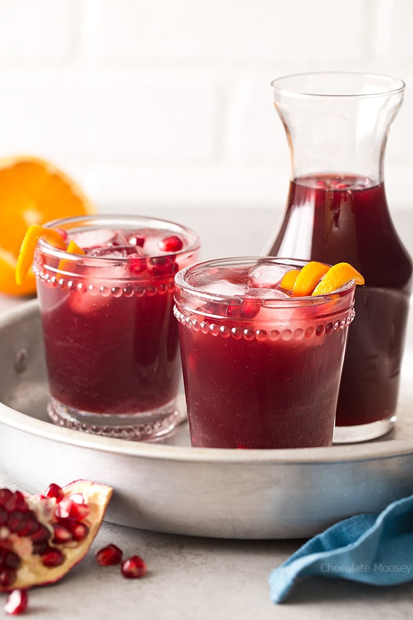 Make your party less boring with small batch Sparkling Pomegranate Punch using prosecco for the bubbly factor! Recipe for a non-alcoholic pomegranate punch also included.