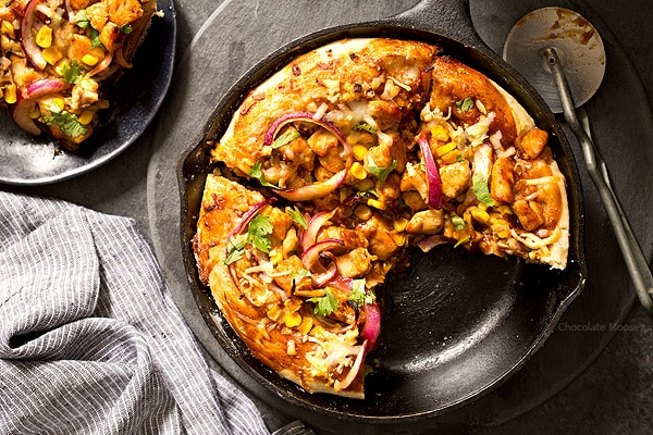 Buying pizza can add up, but luckily you can make it at home with BBQ Chicken Skillet Pizza for two. No need to worry about rolling homemade pizza dough into a perfect circle because you shape the dough inside a cast iron skillet.