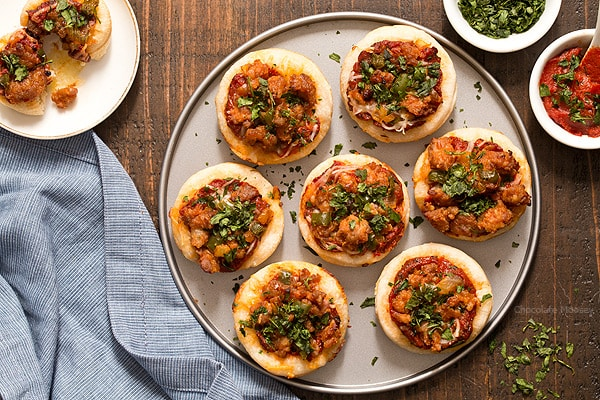 Serving pizza is popular for a party, but sometimes you don't have room for a whole slice. Problem solved with these Italian Sausage Pizza Bites, which are mini pizzas topped with a homemade pizza sauce, mozzarella cheese, and hot Italian sausage with peppers.