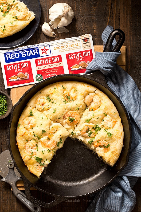 Turn pizza night at home into a special date night dinner with Shrimp Scampi Skillet Pizza For Two with a white wine garlic butter sauce and homemade pizza dough. Ideal for Valentine's Day, anniversaries, birthdays, and days off together.