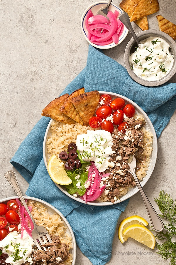Whether you pronounce it jy-roh or yee-roh, one bite of these small scale Slow Cooker Gyro Rice Bowls with homemade tzatziki sauce will transport you to Greece. Recipe makes 4 servings, enough to realistically feed 1-2 people