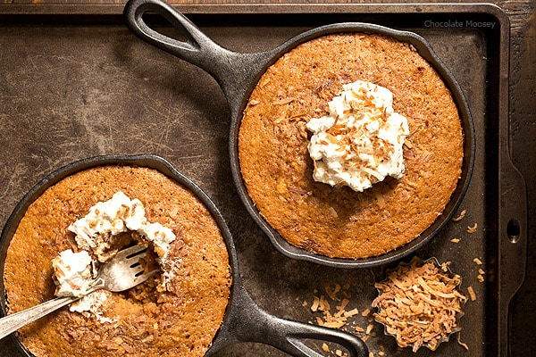 These Toasted Coconut Skillet Cakes with coconut milk are so tender and moist, you don't need to add frosting on top! Serve with homemade whipped cream or a scoop of ice cream.