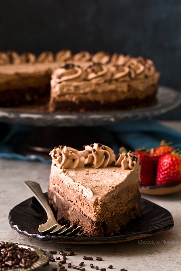 Slice of Brownie Bottom Chocolate Mousse Cake with chocolate whipped cream
