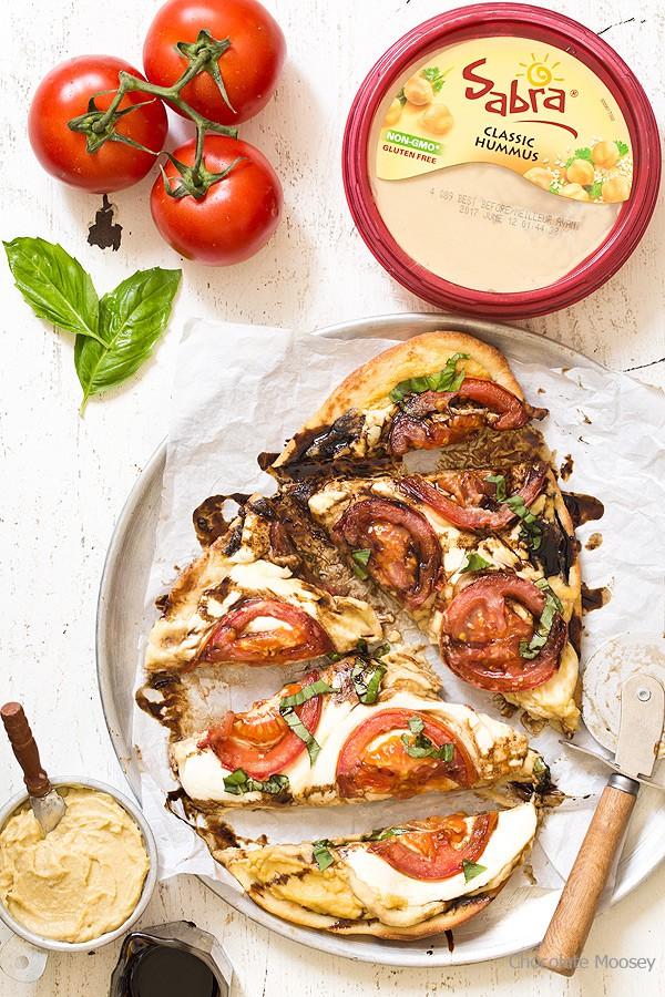 Caprese Flatbread Pizza with hummus, tomatoes, mozzarella cheese, and basil