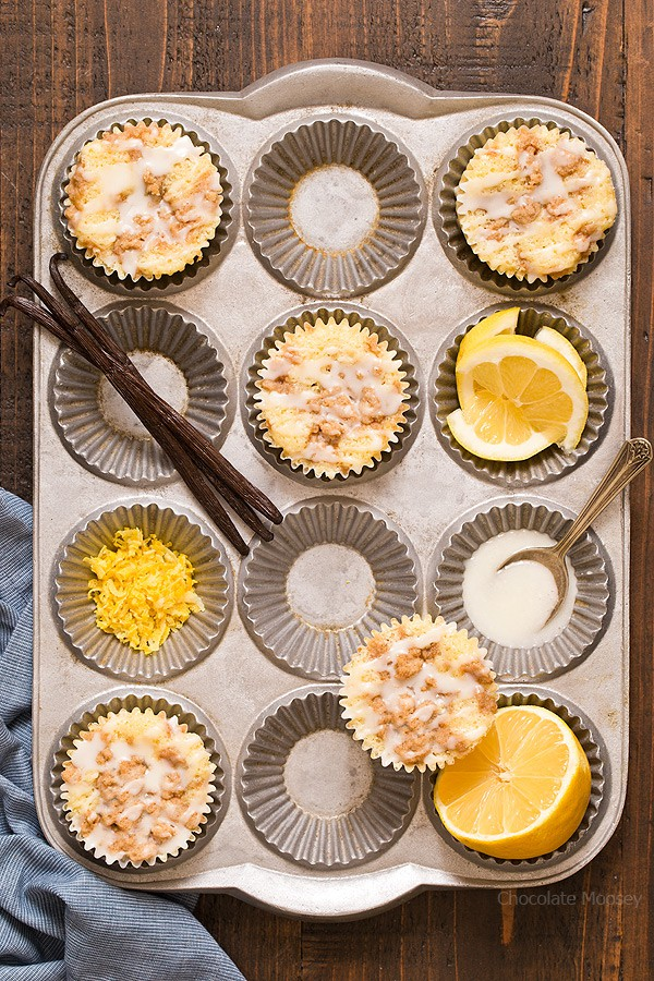 Start your morning with a little sunshine: Lemon Vanilla Crumb Muffins with a crunchy brown sugar streusel and a lemon glaze drizzled on top.