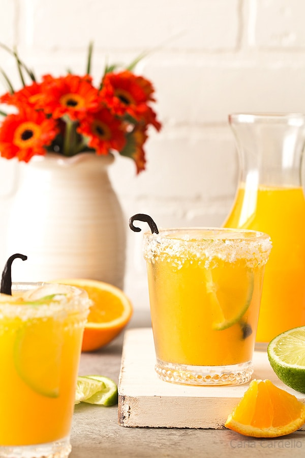 Reminiscent of a creamsicle, these small batch Orange Vanilla Margaritas are made with fresh orange juice, lime juice, and vanilla bean.