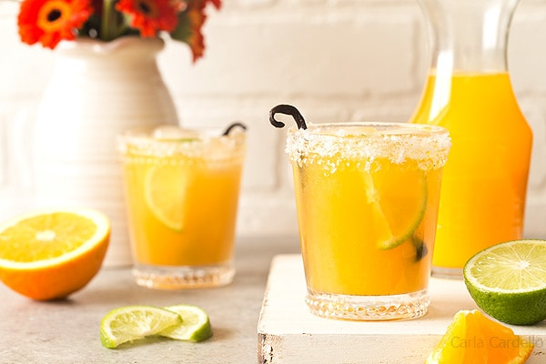 Orange Vanilla Margaritas are made with fresh orange juice, lime juice, and vanilla bean. Recipe makes two drinks.
