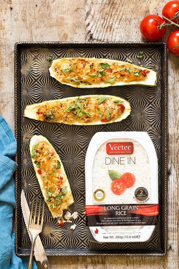 Garlic Parmesan Stuffed Zucchini Boats stuffed with rice, tomatoes, cheese, and basil