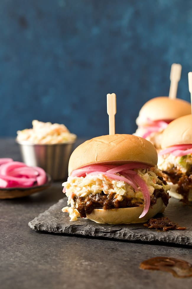 In the mood for barbecue but don't want to turn on the oven? These small batch Slow Cooker Shredded Beef Sliders with an easy homemade barbecue sauce and coleslaw will do the trick!