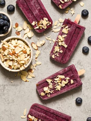 Cool down this summer with something colorful and refreshing! Blueberry Yogurt Pops with almonds and a secret ingredient that makes their flavor pop.